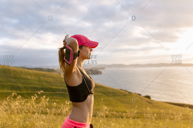 Young woman looking at the sea after workout