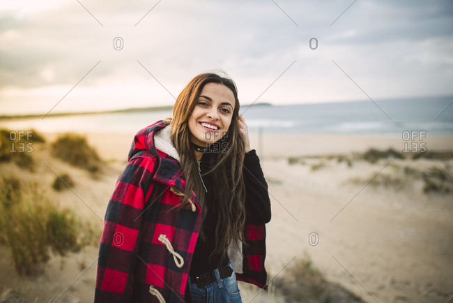 Portrait of relaxed young woman on the beach