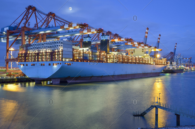 Germany- Hamburg- container ship at terminal in the morning