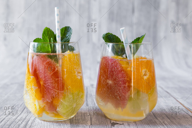 Two glasses of detox water infused with citrus fruits
