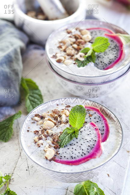 Smoothie bowls with dragon fruit- chia seeds and roasted hazelnuts