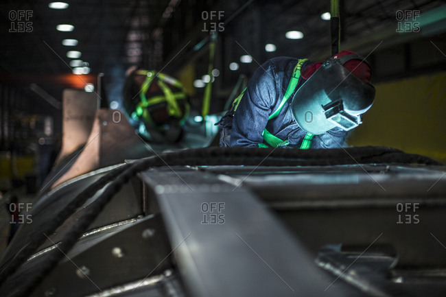 Man welding steel in factory
