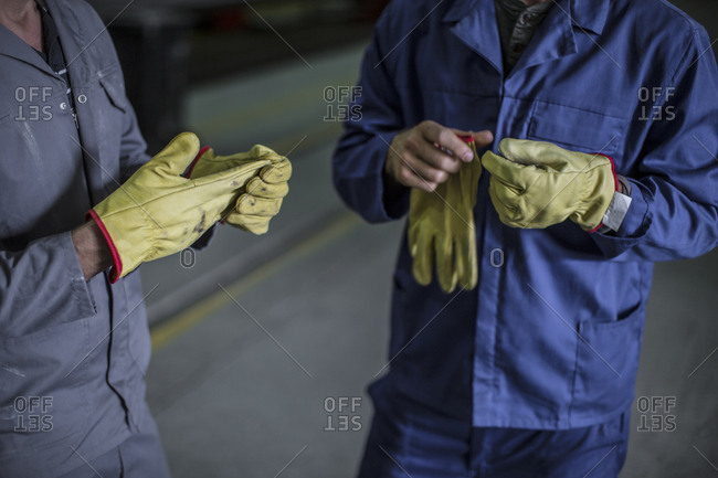 Close-up of factory worker's hands
