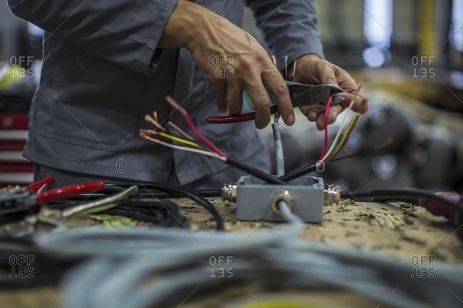 Close-up of mechanics hands in workshop
