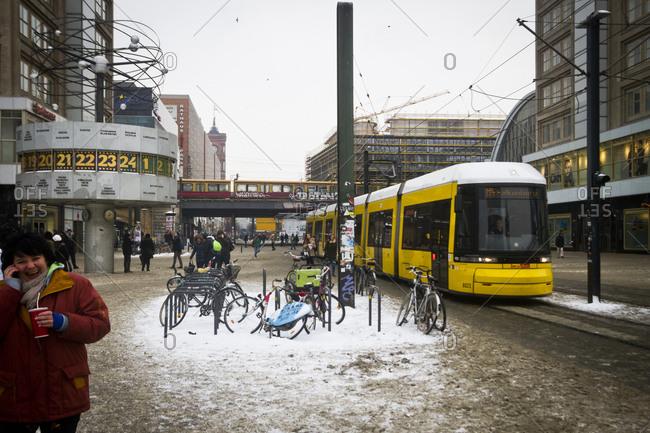 A tram moves through a snow covered Alexanderplatz