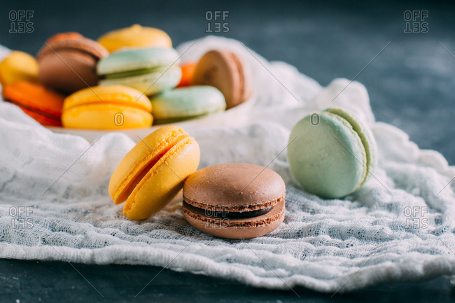 Colorful homemade macaroons on dark background