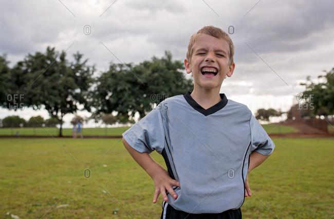 Boy on soccer field making goofy smile