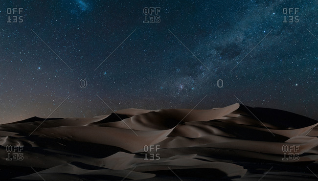 View of dunes under starry night sky, Namib Desert, Namibia