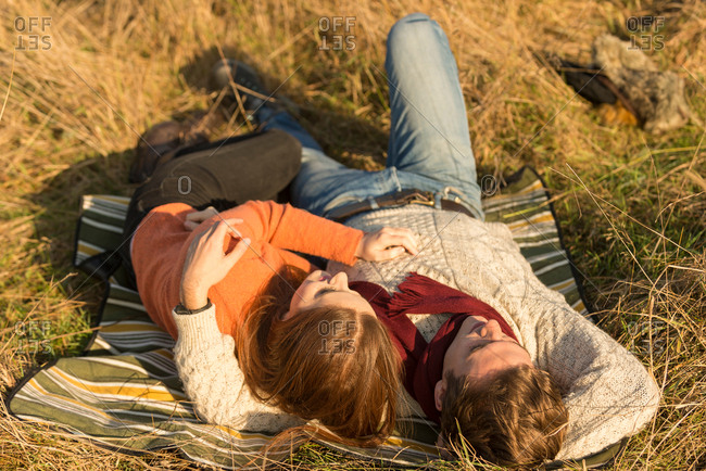 Young couple lying in field