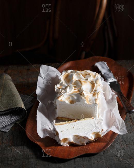 Bistro dessert of bombe Alaska on table