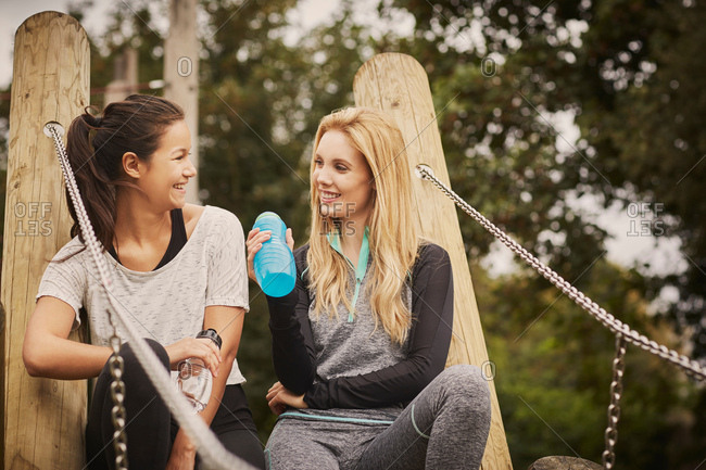 Two women taking a training break in park