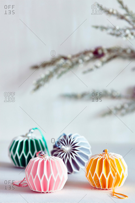 Colorful Christmas baubles with color coordinated ribbon