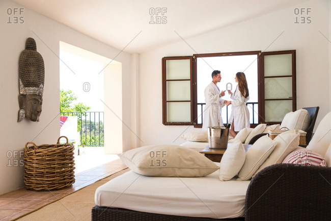 Couple making a champagne toast in boutique hotel suite, Majorca, Spain