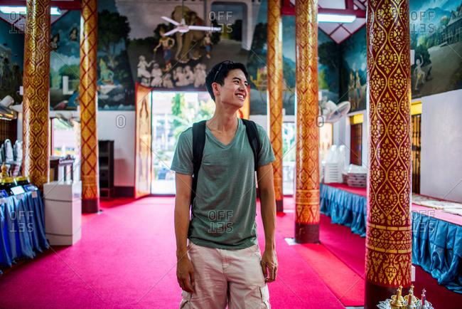 Young man inside Wat Thung Yu Temple, Chiang Mai, Thailand