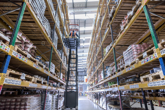 Forklift driver in cable store warehouse at cable storage facility
