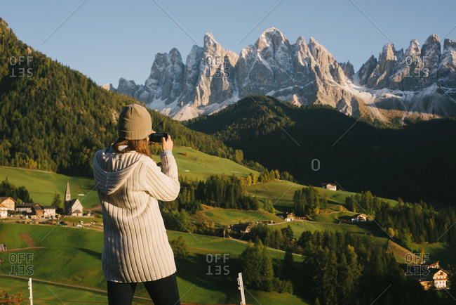 Woman taking photograph, Santa Maddalena, Dolomite Alps, Val di Funes (Funes Valley), South Tyrol, Italy