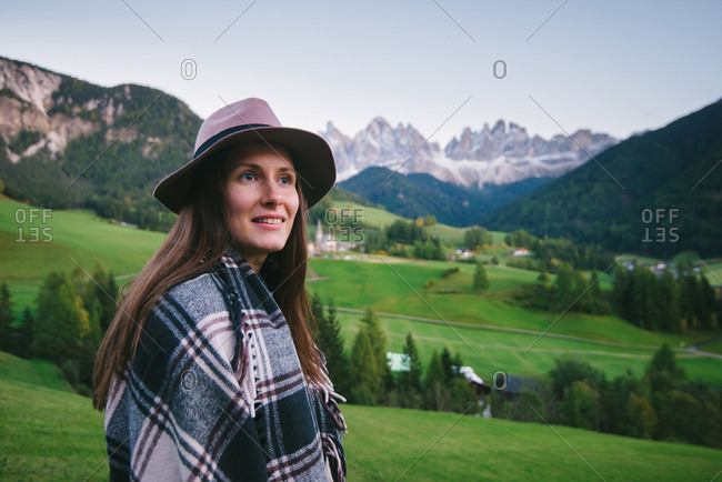 Woman looking into distance, Santa Maddalena, Dolomite Alps, Val di Funes (Funes Valley), South Tyrol, Italy