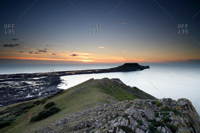 View of Worm's Head at sunset, Rhossili bay, Gower, Wales
