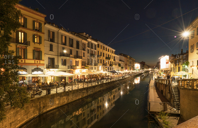 Milan, Italy - August 18, 2016: View of canal waterfront in Navigli district at night, Milan, Italy