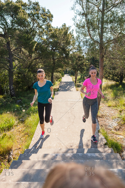 Two female runners running in park, Split, Dalmatia, Croatia