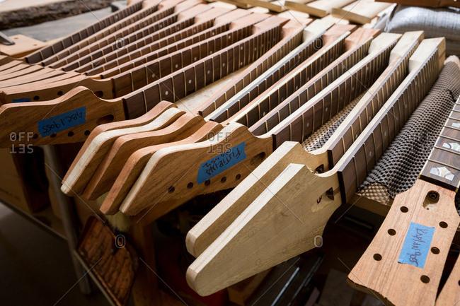 Headstocks and necks of guitars in workshop