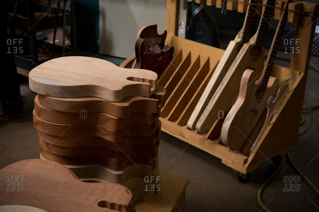 Guitar bodies stacked in workshop