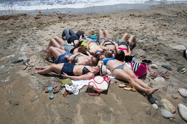 Group of young women sunbathing on beach, Block Island, Rhode Island, USA