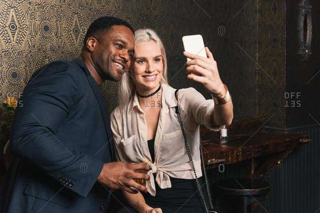 Couple in pub taking a selfie