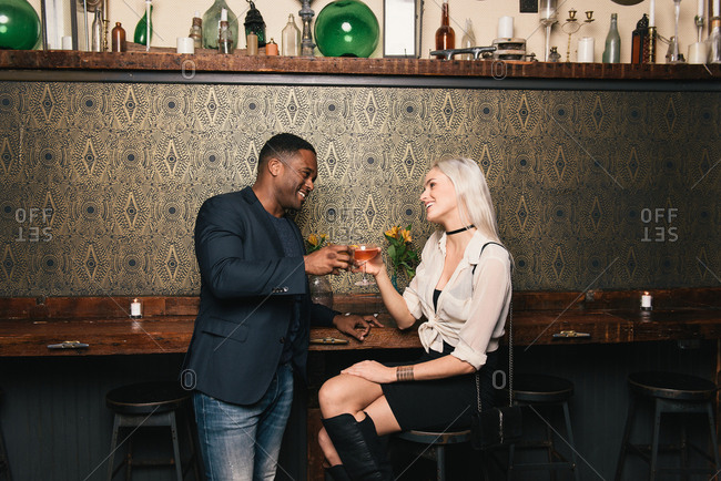 Couple in pub making a toast
