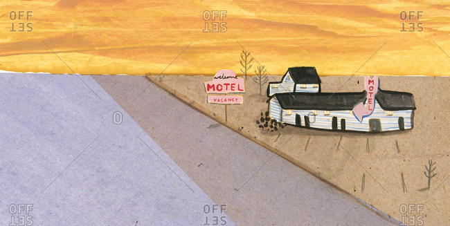 Retro motel in a desert landscape at sunset