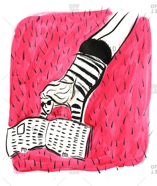 Woman lying on pink rug reading newspaper