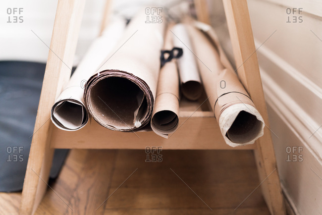Rolls of brown paper on a wooden shelf