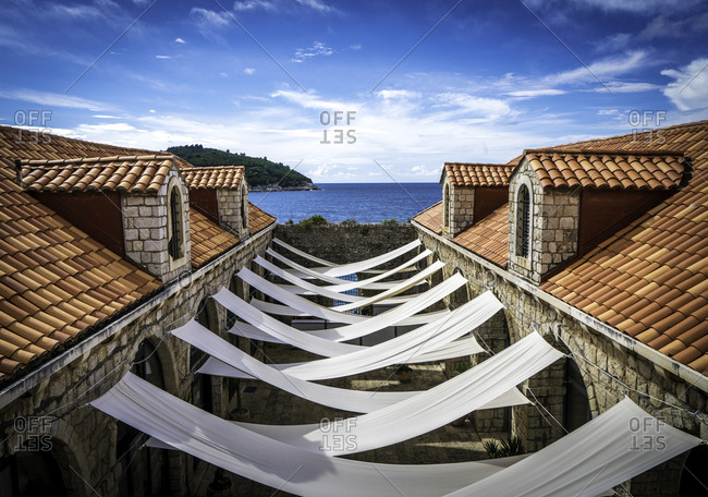 Cloths hung from roofs to provide shade between buildings in Dubrovnik, Croatia