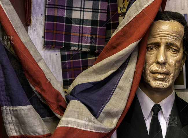 Edinburgh, Scotland - August 7, 2016: Vintage statue of Humphrey Bogart in a thrift store