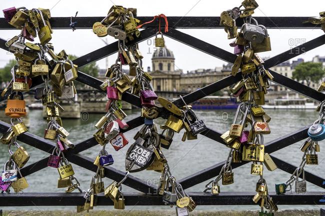 Paris, France - August 19, 2016: Love locks on bridge