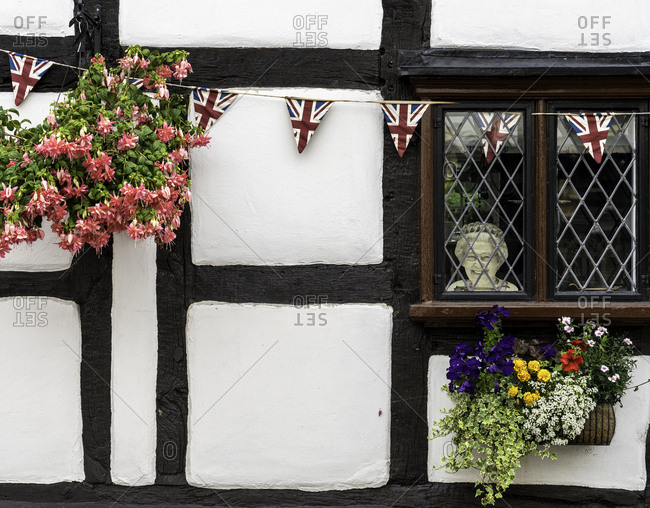 Upton, England - August 11, 2016: Picture of Queen Elizabeth II in the window of a Tudor style house