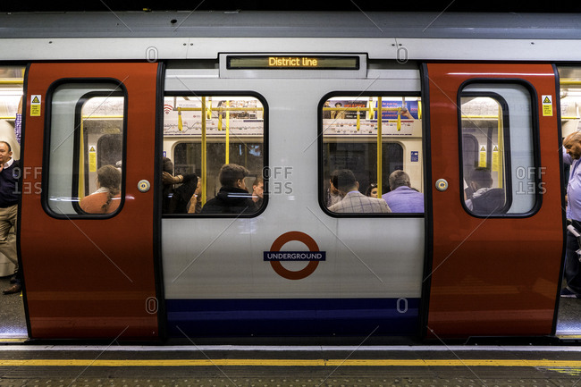 London, England - August 2, 2016: Exterior of underground train stopped at station