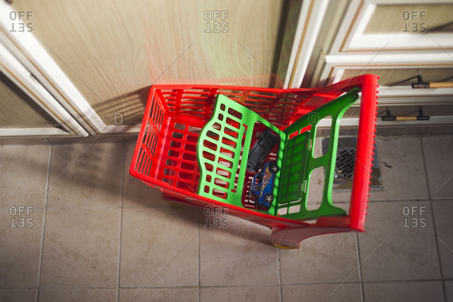 Toy shopping cart and toys