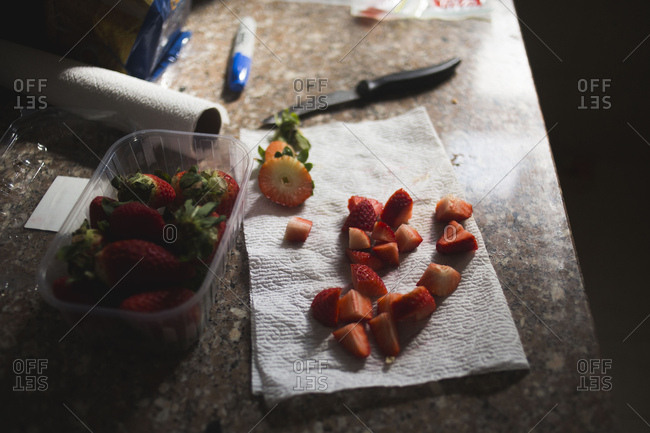 Strawberries chopped on paper towel