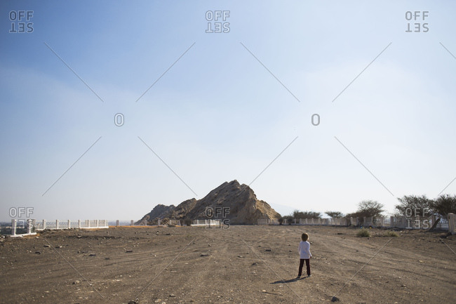 Boy in a dirt lot