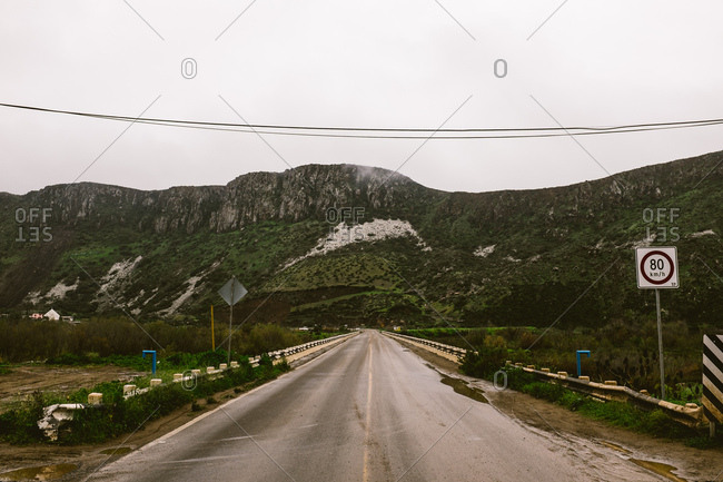 Highway leading to mountains in the Mexican countryside