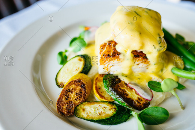 Halibut and vegetable dish with sauce