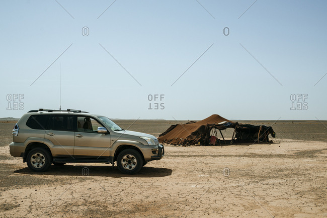 Tent and vehicle in remote desert