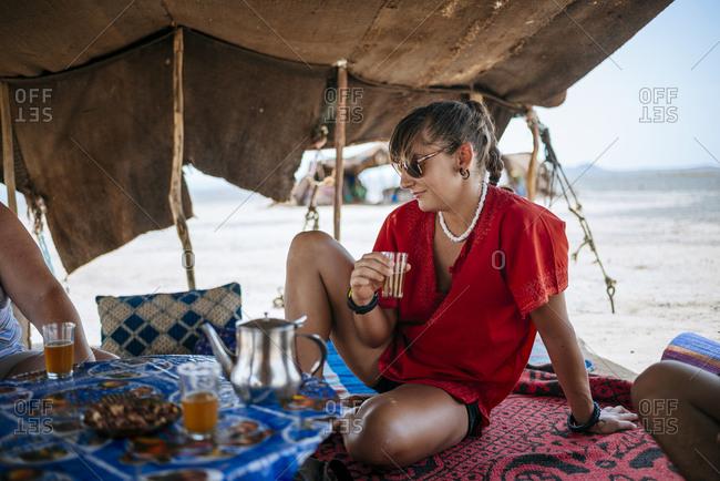 Woman enjoying tea in desert