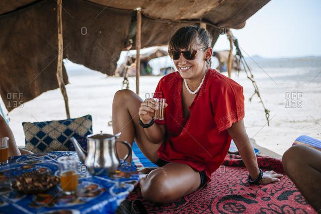 Woman enjoying drink in desert