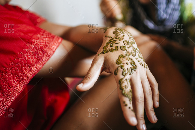 Woman with Moroccan henna painted hand
