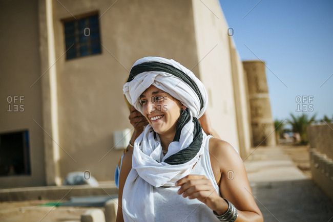 Woman trying on headscarf in Morocco