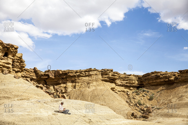 New Mexico - May 14, 2016: Man sitting in remote desert setting