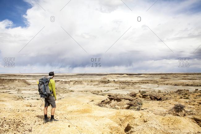 Man in vast desert setting