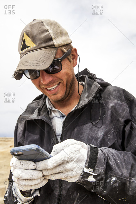 New Mexico - May 17, 2016: Paleontologist using smartphone